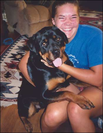 happy rottweiler owner